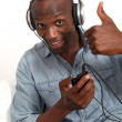 Cheerful man listening to music - Stock Photo
