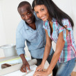Couple choosing new wallpaper for room  — Stock Photo