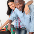 Royalty-Free Stock Photo: Young couple renovating their new house