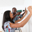 Young couple renovating their new house — Stock Photo #18222291