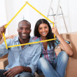 Young couple buying new home — Stockfoto