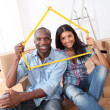 Stock Photo: Young couple buying new home