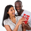 Man offering gift to woman on her birthday — Foto de Stock