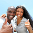 Cheerful couple showing thumbs up — Stock Photo #18222723