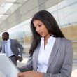 Businesswoman sending email with electronic tablet — Stockfoto