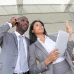 Business team standing outside congress center — Stock Photo