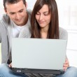 Young couple surfing on internet — Stock Photo #18224061