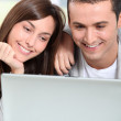 Young couple surfing on internet — Stock Photo #18224067