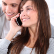 Young couple on telephone conversation - Stock fotografie