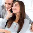 Stock Photo: Young couple on telephone conversation
