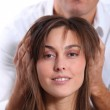 Hairdresser looking for woman's new haircut — Stock Photo #18224663