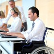 Office worker in wheelchair — Stock Photo
