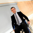 Businessman in wheelchair going to attend congress meeting — Stock Photo
