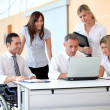 Group of office workers in a business meeting — Stock Photo #18225621