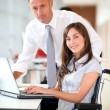 Manager and office worker in wheelchair — Stock Photo