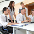 Group of office workers in a business meeting — Stock Photo #18225683