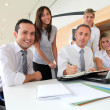 Stock Photo: Group of office workers in a business meeting
