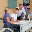 Woman in wheelchair working in the office — Stock Photo #18225781
