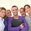 Closeup of smiling group of office workers — Stock Photo #18225955