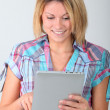 Young woman with electronic pad — Stock Photo