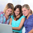 Group of happy girls surfing on internet — Stock Photo #18226255