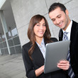 Business meeting outside with electronic tablet — Stock Photo