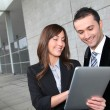 Business meeting outside with electronic tablet - Stock fotografie