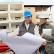 Architect and engineer looking at plan on construction site — Stock Photo #18226733