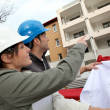 Architect and engineer looking at plan on construction site — Stock Photo #18226737