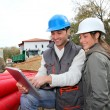 Architect an site supervisor on construcion site - Stock Photo