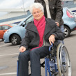 Stock Photo: Young massisting senior womin wheelchair