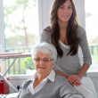 Stock Photo: closeup of elderly woman with young woman