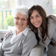 Closeup of elderly woman with young woman — Stok fotoğraf