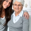 Closeup of elderly woman with young woman — Stock Photo #18226935