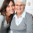 closeup of elderly woman with young woman — Stock Photo #18226961
