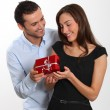 Stock Photo: Moffering present to girlfriend