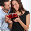 Man offering present to girlfriend — Stock Photo