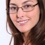 Closeup of beautiful woman wearing eyeglasses — Stock Photo #18227539