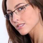 Closeup of beautiful woman wearing eyeglasses — Stock Photo #18227543