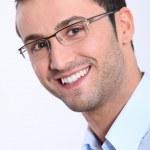 Closeup of smiling man with eyeglasses — Stock Photo #18227547