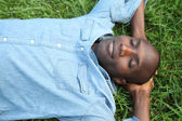 Man taking a nap in park — Stock Photo