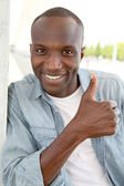 Portrait of smiling man showing thums up — Stock Photo