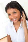 Portrait of smiling customer service operator — Stock Photo