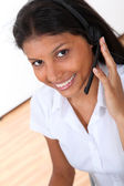 Portrait of smiling customer service operator — Stock Photo