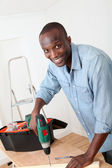 Man using electric drill at home — Stock Photo