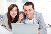 Young couple surfing on internet — Stock Photo