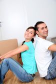 Young couple moving in new house — Stock Photo