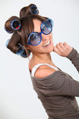 Young funny woman with hair-curlers — Stock Photo