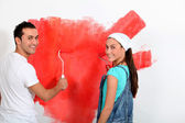 Couple having fun painting their new house — Foto de Stock