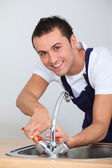 Young man fixing sink — Stock Photo